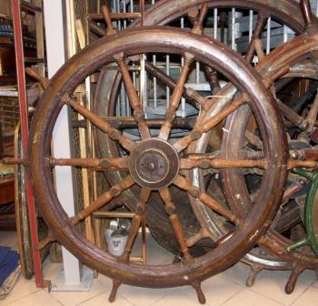 Salvaged mid 19th century ten-spoked ships wheel in teak. Wood and iron hub (incl part of the shaft). With double brass bands.