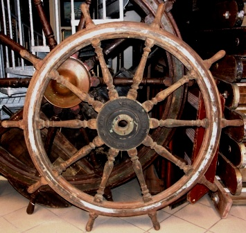 Late 19th century ten-spoked ships wheel. Made of teak. With double brass bands and central brass hub. Made by Elcano - B.D.T. Manises España.
