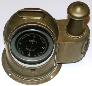 "20th century unpolished brass binnacle with brass domed cover, observation window and kerosene lighting house for night viewing. ""Silva""compass made by AB Bröderna Kjellström, Stockholm."