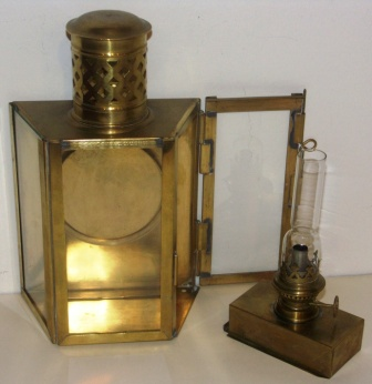 Early 20th century brass kerosene bulkhead lamp. With detachable burner/container.