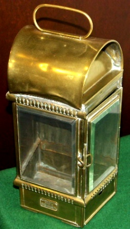 Early 20th century bulkhead light in brass with bevelled glass. Kerosene burner missing. Made by Eli Griffiths & Sons, Birmingham.