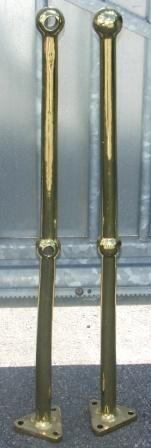 A pair of early 20th century solid brass stanchions