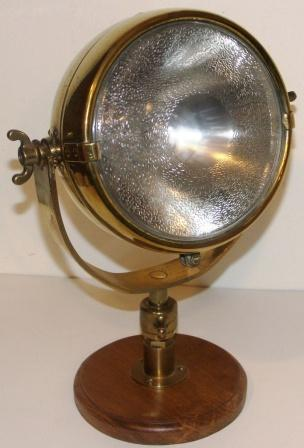 "Mid 20th century electric revolving brass searchlight ""RAYDYOT"", made by J. Neale and Sons Ltd., Birmingham, England."