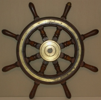 1920's eight-spoked ships wheel. Teak, brass band