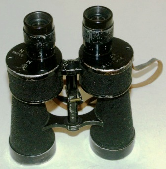 "WWII German Navy ""Kriegsmarine"" binocular. Marked with the Swastika symbol, M (Marine), N28495 beh & 364866 (T) KF. 7x50. Black lacquered metal."