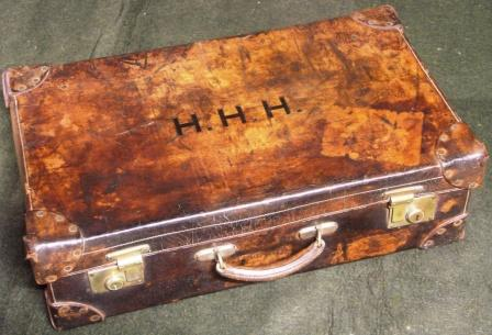 Early 20th century leather suitcase furnished with silver and stainless travelling accessories. Marked with the initials H.H.H. Made by Drew & Sons, Picadilly Circus W.