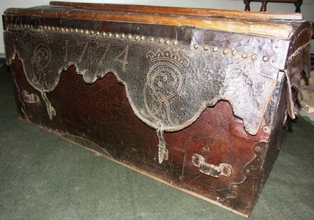18th century leather bound travellers' trunk. Dated 1774 and marked with crowns and the initials CR.