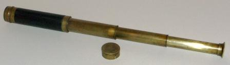 Early 20th century hand-held refracting telescope, maker unknown. Three brass draws and leather bound tube.