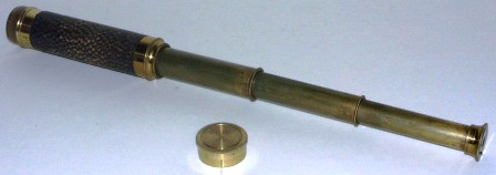 Early 20th century hand-held refracting telescope, maker unknown. With three brass draws and leather bound tube.