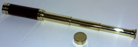 Late 19th century hand-held refracting telescope, maker unknown. With three brass draws and mahogany bound tube.