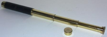 Early 20th century hand-held refracting telescope made by Denhill. Model: Venus 18x.With three brass draws and leather bound tube.