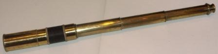 19th century hand-held refracting telescope. Maker unknown. Three brass draws and rope bound tube.