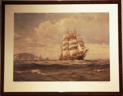 Seascape with barque heading for open sea.