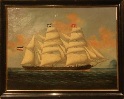A three-masted barque in full sail flying the German and Hamburg flag