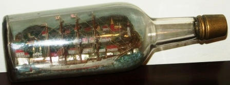 Early 20th century sailor-made ship model housed in bottle depicting the Swedish 4-masted barque VINGA and tug boat.