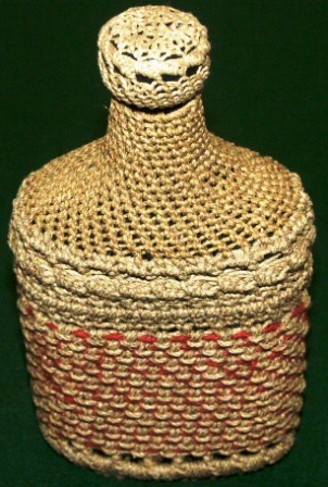 Rope-coated glass bottle with decorative pattern