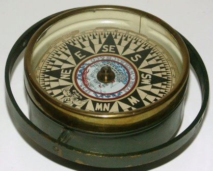 19th century dry compass. Brass, mounted in gimbals. Made by Iver C. Weilbach & Co.