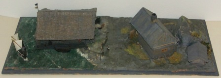 20th century built model depicting a fisherman's home and boathouse (with detachable roofs) on the island Nämndö of Stockholms archipelago. Built 1965-67. Signed H. Biärsjö. Mounted in glass case.