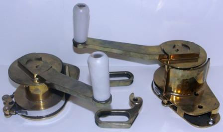 A pair of 20th century sailboat winches, made of brass.