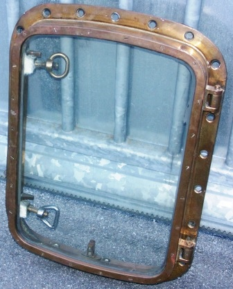 20th century brass porthole with lid to open from inside