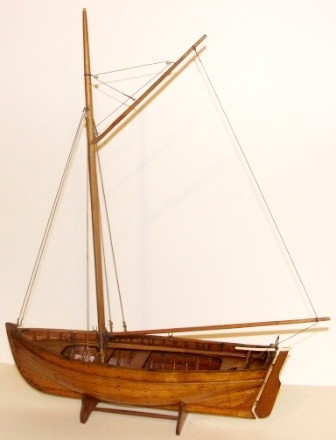 Early 20th century carvel-built, gaff-rigged and copper riveted wooden sailing boat. With tiller made of bone.