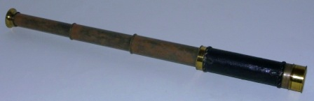 Late 19th century hand-held refracting telescope, maker unknown. With three brass draws and leather bound tube.